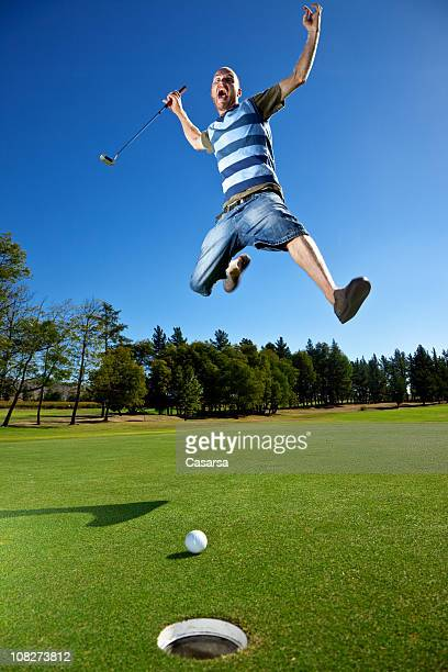 Angry Golfer Yelling and Jumping on Golf Green Near Hole