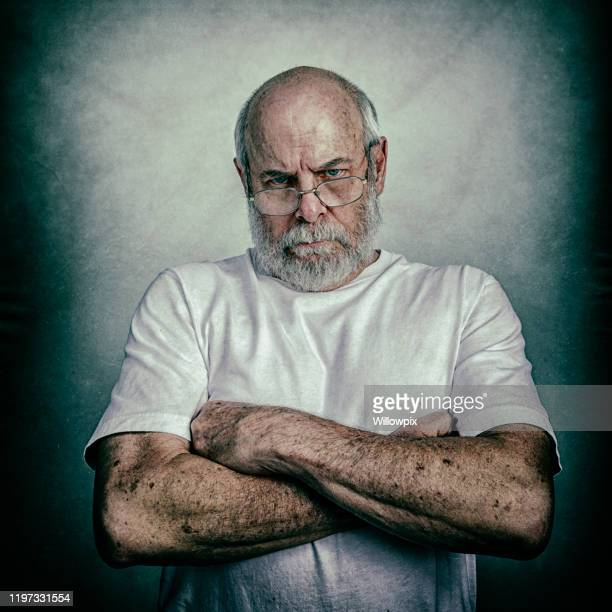 angry grumpy scolding arms crossed senior adult man - sulking stock pictures, royalty-free photos & images