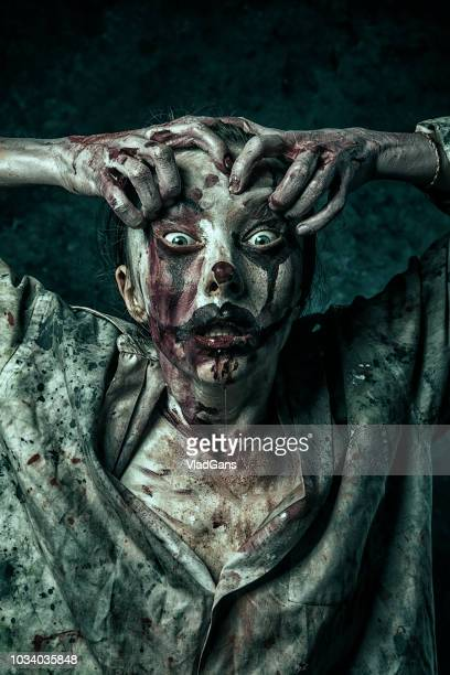 angry halloween clown - very scary monsters stock photos and pictures