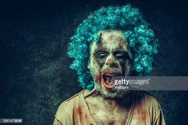 angry halloween clown - holiday card stock photos and pictures
