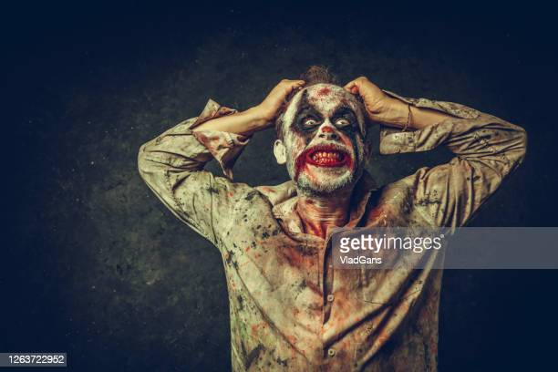 angry halloween clown - hooligan stock pictures, royalty-free photos & images
