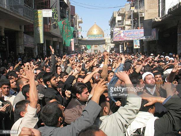 Angry Iraqis protest in front of the house of Iraq?s powerful Shiite cleric Ali al-Sistani over the bombing of a Shiite holy shrine on February 22,...