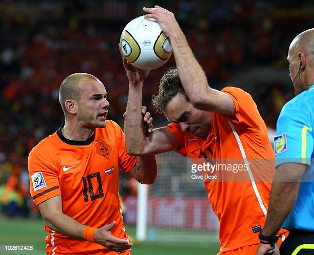 Angry Joris Mathijsen of the Netherlands throws the ball to the ground after he feels the goal scored by Andres Iniesta of Spain was offside as team...