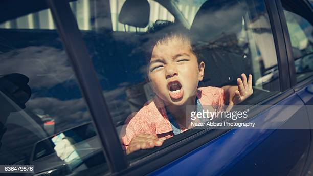 Angry Kid Shouting in car.