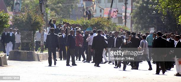 Angry lawyers pelting stones outside the district court after a police inspector shot a lawyer in the court premises on March 11 2015 in Allahabad...