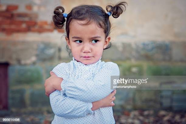 angry little girl - ethnicity stock pictures, royalty-free photos & images