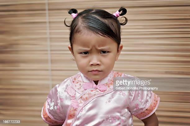Angry little girl wearing cheongsam