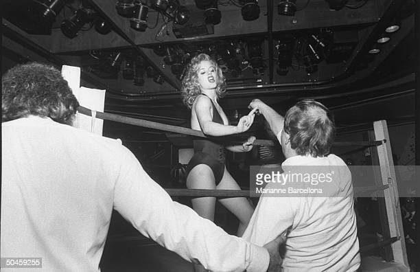 Angry looking woman pugilist Kitty Burrows seen arguing w male fans who pay $75 to give advice to members of Billy Deans Foxy Boxing revue Great...