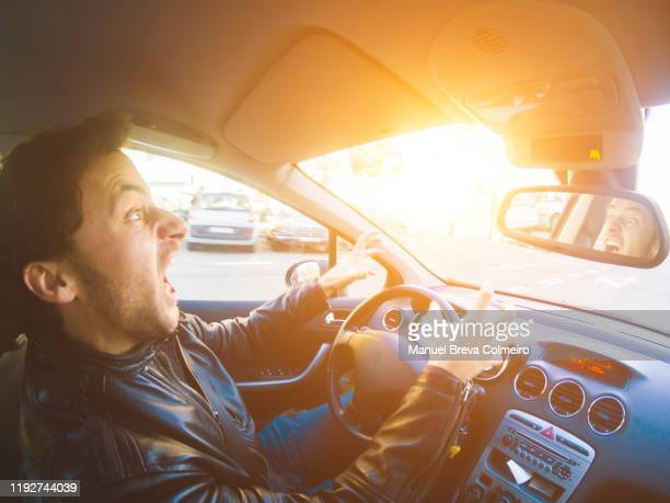 angry man driving - green car crash stock pictures, royalty-free photos & images
