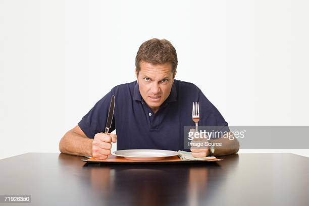 Angry man waiting for meal