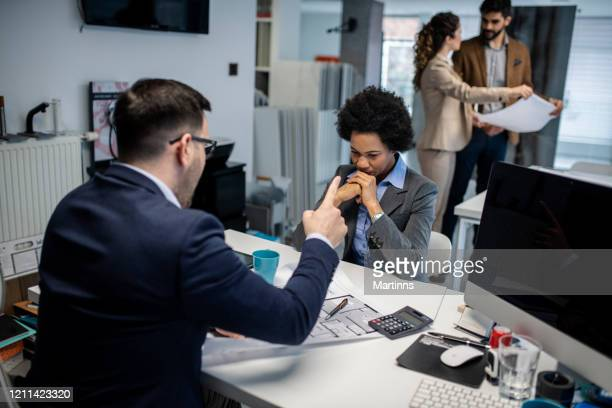 angry manager scolding his subordinate at the office - harassment stock pictures, royalty-free photos & images