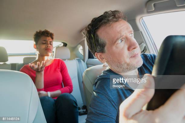 Angry Millennial Passenger Complaining to Lost Driver with Mobile Phone