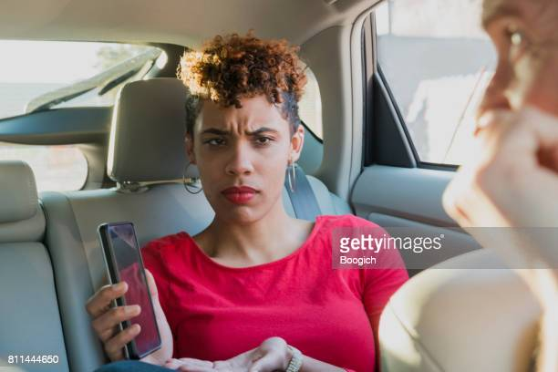 Angry Millennial Passenger Shows Lost Driver Mobile Phone Miami USA