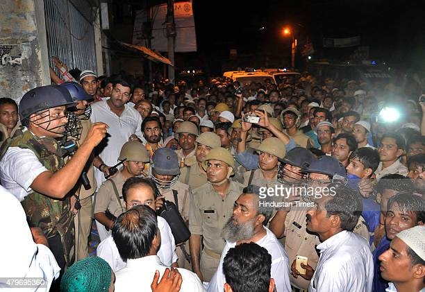 Angry mob at Nagfani police station after an objectionable WhatsApp message sparked communal tension on July 5 2015 in Moradabad India Tension had...