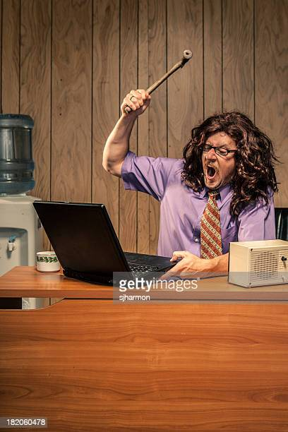 Angry Office Worker With Hammer Smashing Computer Violently
