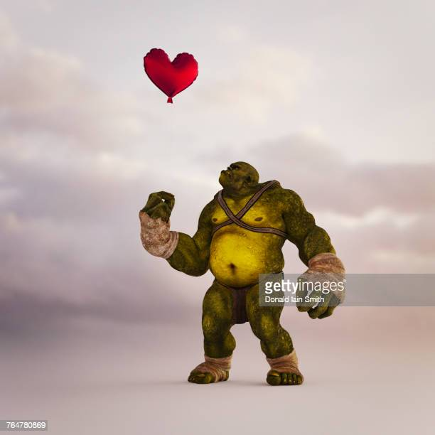 Angry ogre looking up at floating red balloon heart