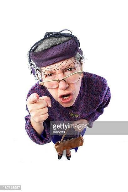 Angry old lady with eyeglasses pointing finger