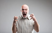 angry old man getting crazy or a wolf