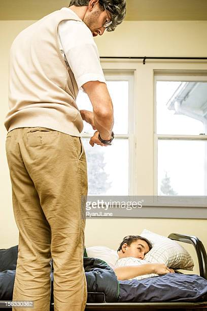 angry parent scolds sleeping teen - scolding stock photos and pictures