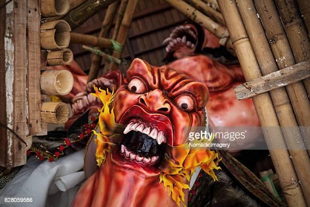 angry red faced ogoh-ogoh demon - devil costume imagens e fotografias de stock