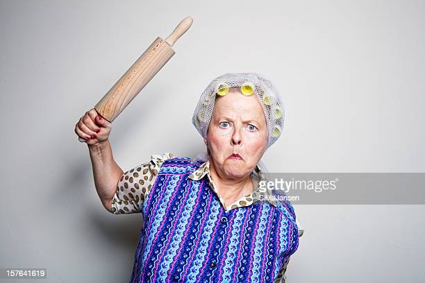 angry retro senior housewife with rolling pin