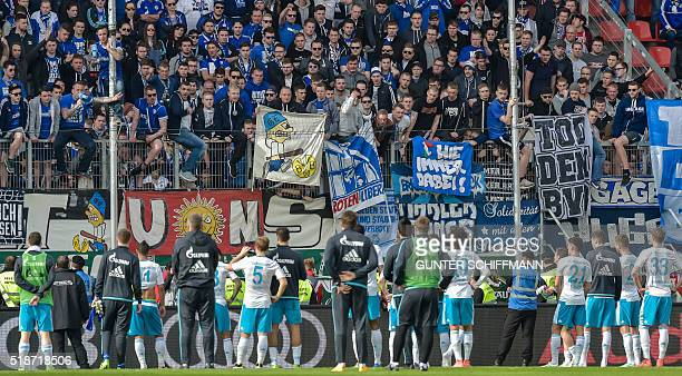 Angry Schalke fans insult players of the team after the German first division Bundesliga football match FC Ingolstadt 04 vs FC Schalke 04 in...