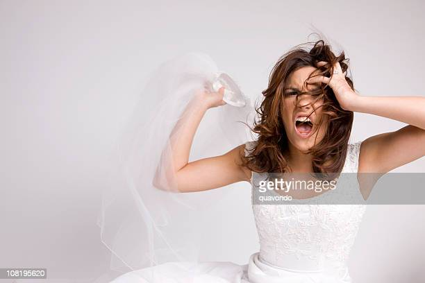 angry screaming bride throwing veil - misnoegd stockfoto's en -beelden