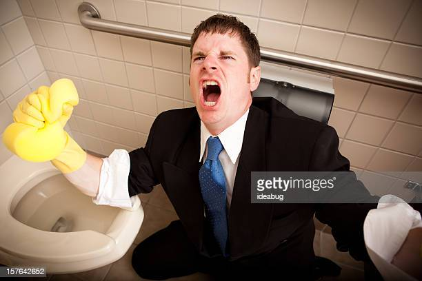 angry, screaming businessman cleaning the restroom toilet - professional cleaning stock photos and pictures
