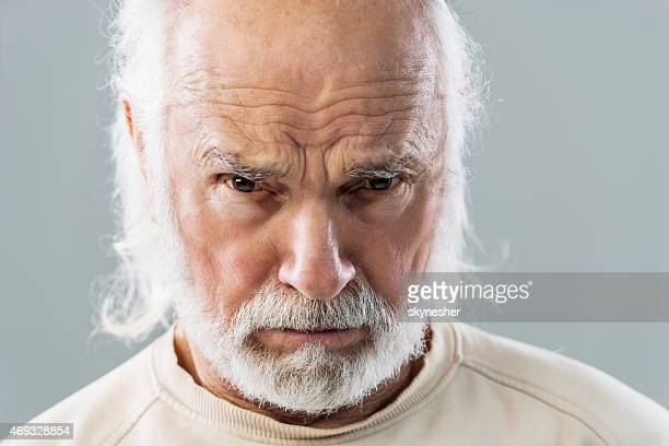 Angry senior man looking at the camera.