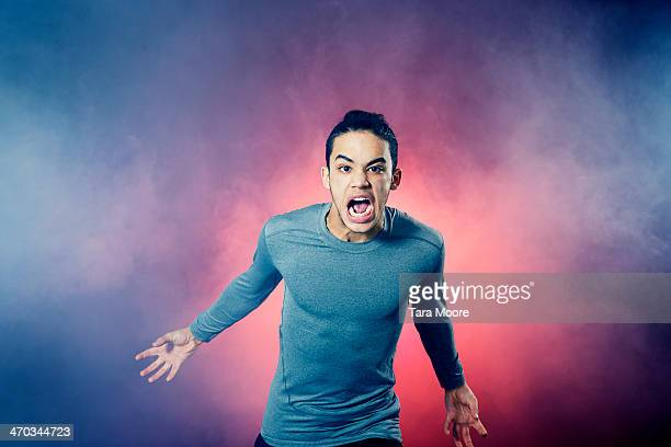 angry sports man running through smoke