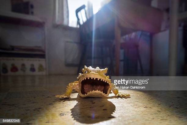 Angry toy lizzard on floor