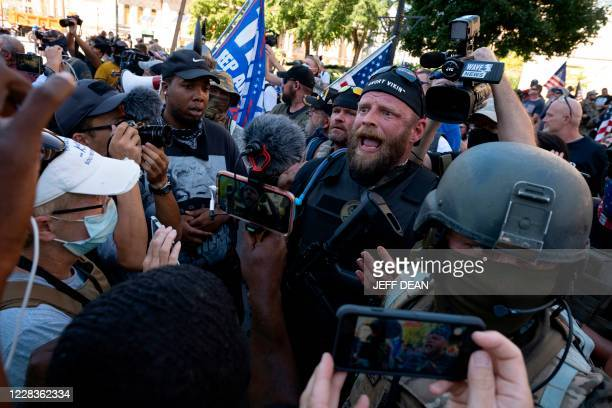 Angry Viking, the leader of a right wing militia, speaks to counter-protesters in front of the Louisville courthouse on September 5, 2020. - Members...