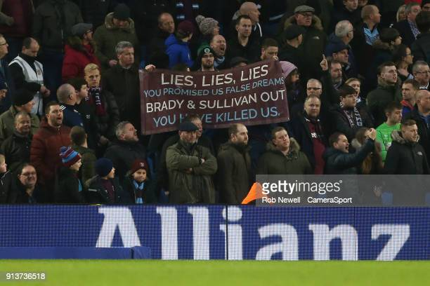 Angry West Ham fans with an anti Board banner during the Premier League match between Brighton and Hove Albion and West Ham United at Amex Stadium on...