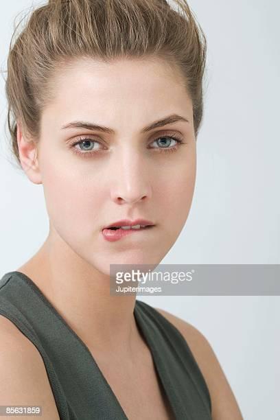 Angry woman biting lip