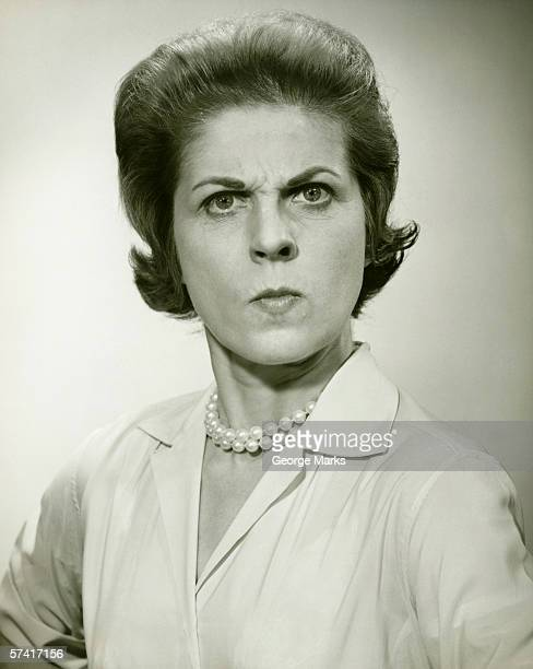 Angry woman in studio, (B&W), (Portrait)