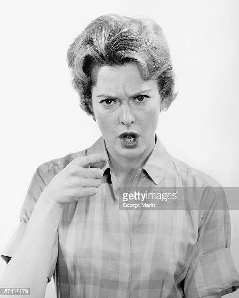 Angry woman in studio, (B&W), (Portrait)