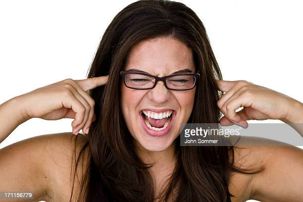 angry woman - fingers in ears stock pictures, royalty-free photos & images