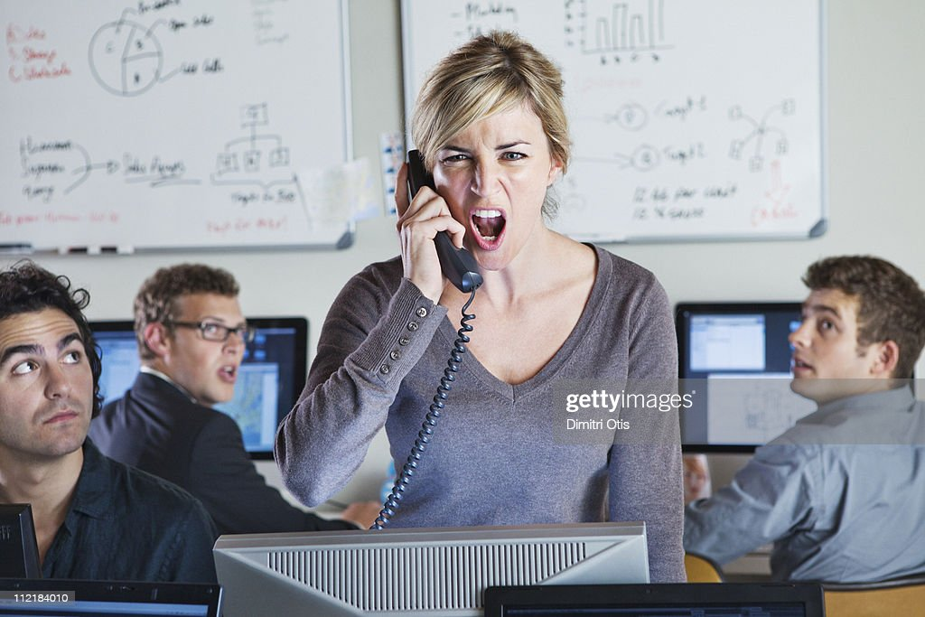 Angry woman shouting on the phone : Stock Photo