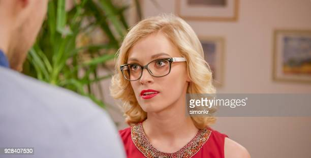 angry woman staring - thick rimmed spectacles stock photos and pictures