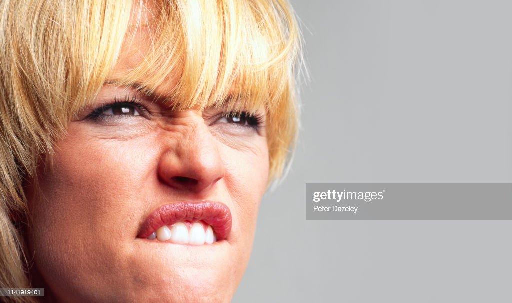 Angry woman swearing : Stock Photo