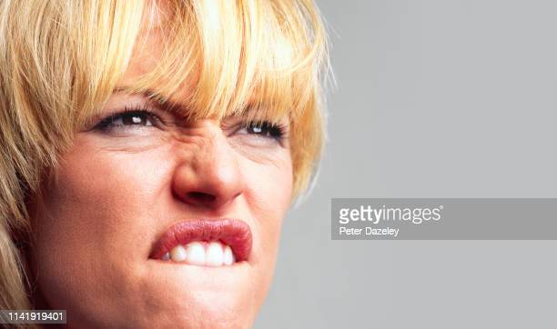 angry woman swearing - anger stock pictures, royalty-free photos & images