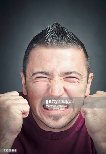 angry young man - clenching teeth stock pictures, royalty-free photos & images