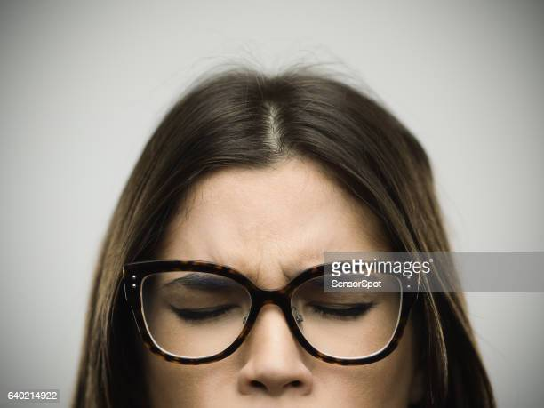 Angry young woman eyes closed