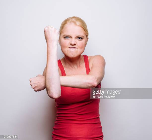 Angry Young woman in red shirt