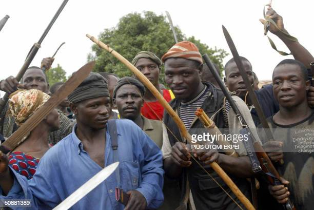 Angry youths of Bakin Ciyawa get ready to defend their town with their machetes bows and arrows in absence of security operatives 21 May 2004...