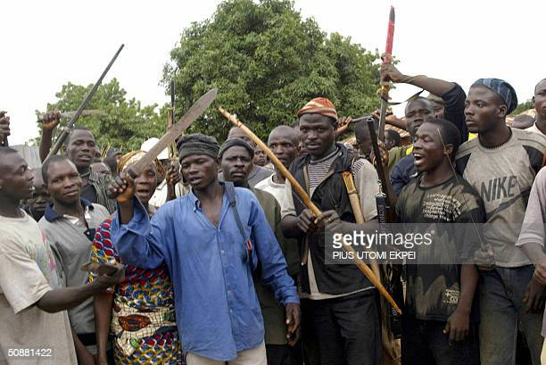 Angry youths of Bakin Ciyawa get ready to defend their town with their machetes bows and arrows in absence of security operatives Friday 21 May 2004...