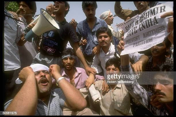 Anguished anti-Pakistan demonstrators w. Save Kashmir save India... Sign protesting Pakistan's interference in Kashmir.