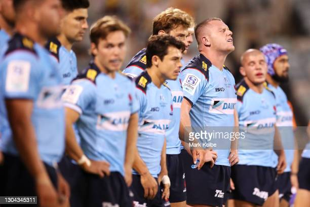 Angus Bell of the Waratahs and his team mates look dejected after a Brumbies try during the round two Super RugbyAU match between the Brumbies and...