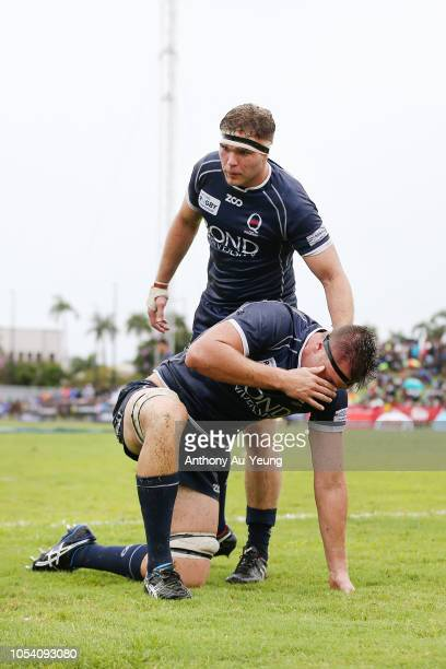 Angus Blyth of Queensland Country is helped up by teammate Angus ScottYoung after a knock during the NRC Grand Final match between Fijian Drua and...