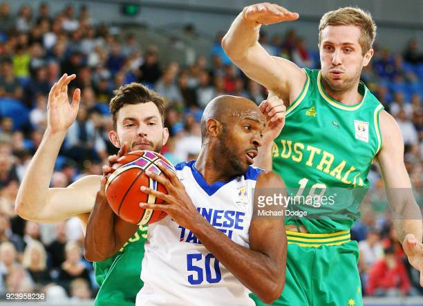 Angus Brandt and Jesse Wagstaff of the Boomers pressure Quincy Spencer Davis III of Chinese Taipei during the FIBA World Cup Qualifying match between...